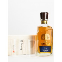 composition of one bottle of Japanese Whisky, the Nikka and two tasting glasses