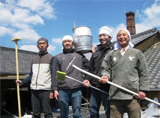 The team of producers from Enoki Shuzo brewery posing with their tools