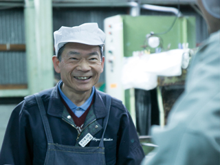 Portrait of smiling Toji in the sake brewery Hayashi Honten