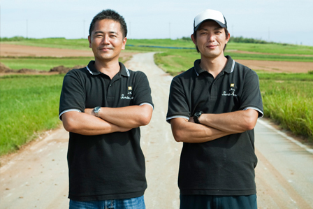 In the sugar cane fields, portrait of two young men, Japanese rum producers in Iejima Island